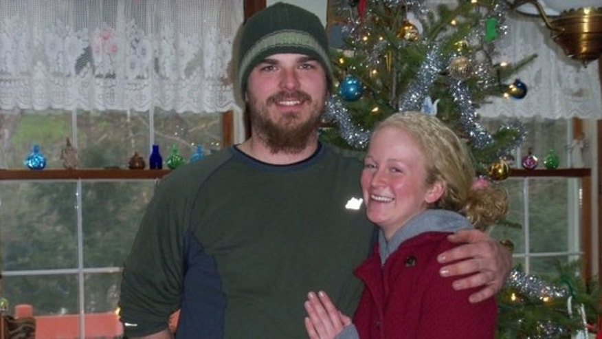 Timothy Davison, left, is pictured in this undated photo provided by his family.