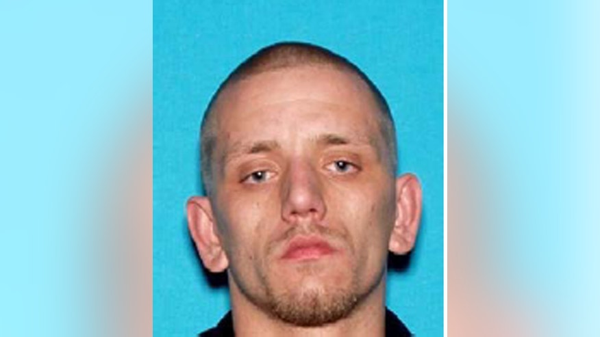 This image provided by the Napa Police department shows Ryan Scott Warner, who was detained at a San Francisco Bay Area commuter train station along with Sara Krueger Sunday Feb. 2, 2014 in the city of El Cerrito, Calif. The couple was wanted for questioning in the death of Krueger's 3-year-old daughter. (AP Photo/Napa Police Department)