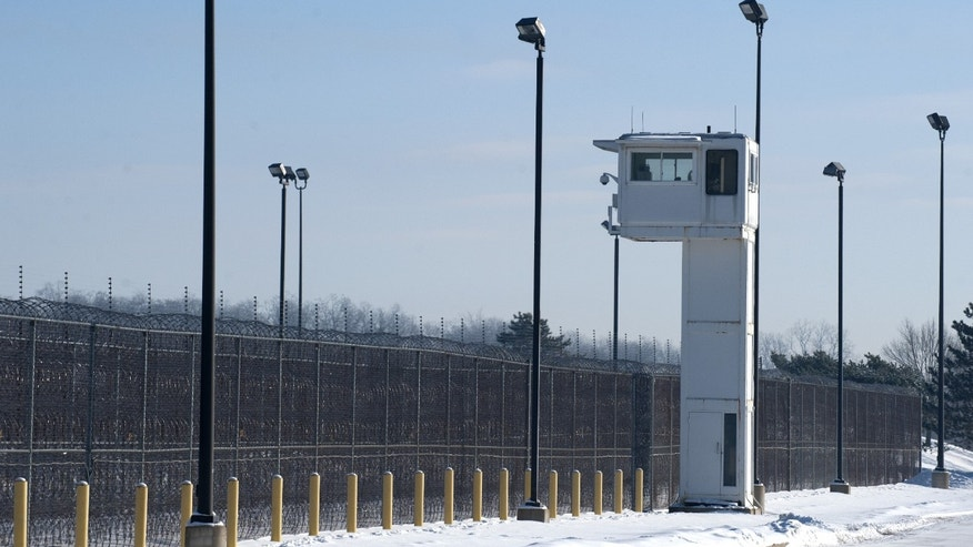 A guard tower stands over fencing at the Ionia Correctional Facility Monday, Feb. 3, 2014.  A national manhunt is underway for convicted killer Michael Elliot  who escaped from the prison on Sunday. (AP Photo/The Grand Rapids Press, Chris Clark) ALL LOCAL TV OUT&#x3b; LOCAL TV INTERNET OUT