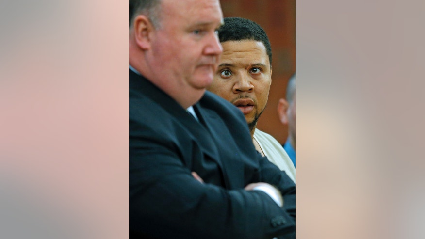Alexander Bradley, an associate of former New England Patriots football player Aaron Hernandez, looks at his attorney Robert Pickering, left, during arraignment on weapons charges Tuesday, Feb. 4, 2014, in Superior Court in Hartford, Conn. Bradley was shot in the leg outside a Hartford nightclub Sunday night, where police said he returned gunfire. Bradley alleges he was shot in the face by Hernandez in Florida last year. (AP Photo/Boston Herald, Nancy Lane , Pool)