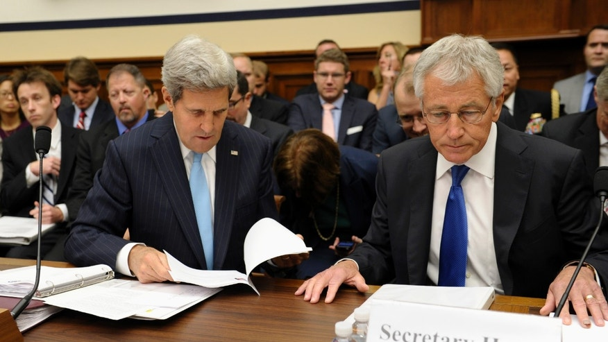 FILE - In this Sept. 10, 2013, file photo, Secretary of State John Kerry, left, and Defense Secretary Chuck Hagel, right, prepare to testify on Capitol Hill in Washington, before the House Armed Services Committee hearing on Syria. Kerry has spent nearly half of his first year as secretary of state jumping on and off airplanes and diving headlong into some of the world's most difficult problems.(AP Photo/Susan Walsh, File)
