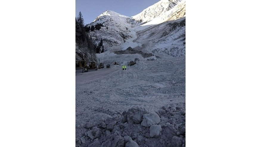 February 4, 2014: This photo provided by the Alaska Department of Transportation shows snow from an avalanche covering a road outside of Valdez, Alaska. Alaska highway officials say they expect to reopen an avalanche-choked highway by Wednesday afternoon, nearly two weeks after walls of snow cut off the only road into Valdez. (AP Photo/Alaska Dept. of Transportation)
