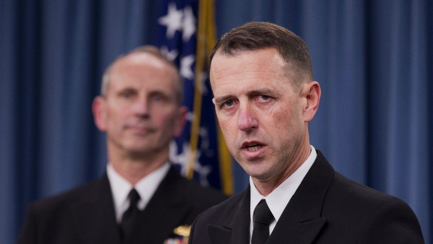 Adm. John M. Richardson, director of the Naval Nuclear Propulsion Program, right, accompanied by Chief of Naval Operations Adm. Jonathan W. Greenert speaks during a news conference at the Pentagon, Tuesday, Feb. 4, 2014.  The Navy is investigating alleged cheating on tests by senior enlisted sailors training on naval nuclear reactors at Charleston, S.C., officials said Tuesday   (AP Photo/Manuel Balce Ceneta)