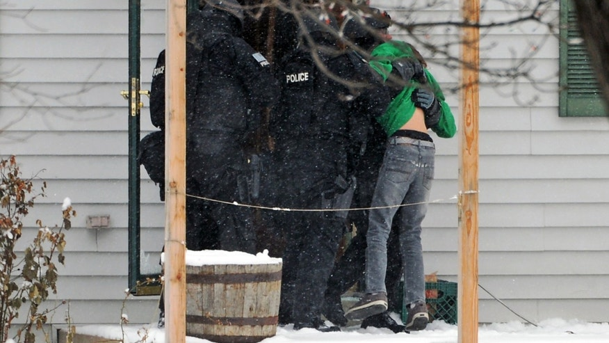 A SWAT team member carries out a 13-year-old boy who was held hostage for nearly 18 hours by 34-year-old Don Pooley, Tuesday, Feb. 4, 2014 in Arvada, Colo. Police say officers fatally shot Pooley when he went to the door of the house he was barricaded in to retrieve unspecified items left by negotiators. Members of the SWAT team immediately rescued the boy. (AP Photo/The Denver Post, RJ Sangosti) MAGS OUT; TV OUT; INTERNET OUT; NO SALES; NEW YORK POST OUT; NEW YORK DAILY NEWS OUT