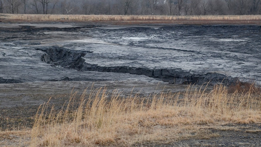 An undated photo of gullies in the coal ash pond at the Duke Energy Dan River Steam Station in Eden, N.C., show where coal ash flowed towards the Dan River beyond the far berm.   Duke Energy said Tuesday,  Feb. 4, 2014, that an estimated 50,000-82,000 tons of coal ash and water was released from a pond at its retired power plant in Eden into the Dan River.     (AP Photo/The Charlotte Observer, John D. Simmons) MAGS OUT; TV OUT; NEWSPAPER INTERNET ONLY