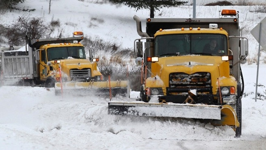 Feb. 5, 2014: PennDot trucks clear snow on an entrance to the Joseph McDade Expressway on in Scranton, Pa.