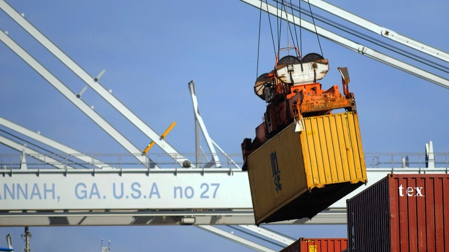 In this Monday, Jan. 27, 2014, photo, a ship to shore crane unloads a shipping container at the Georgia Ports Authority Garden City terminal, in Savannah, Ga. The Commerce Department reports on the U.S. trade deficit for December on Thursday, Feb. 6, 2014. (AP Photo/Stephen B. Morton)