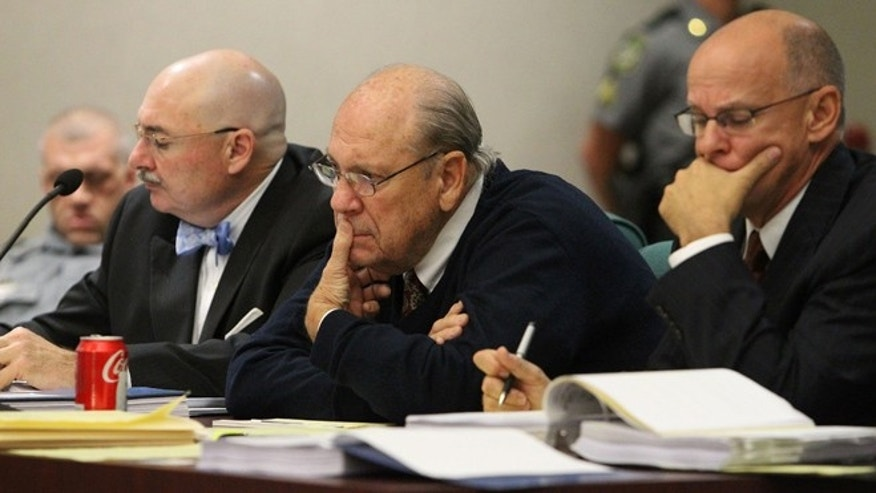 Feb. 7: Former Tampa Police captain Curtis Reeves, Jr., center, sits beside his defense attorneys Richard Escobar, right, and Dino Michaels as they listen to his taped interview by detectives during his bond reduction hearing before Circuit Judge Pat Siracusa at the Robert D. Sumner Judicial Center in Dade City.