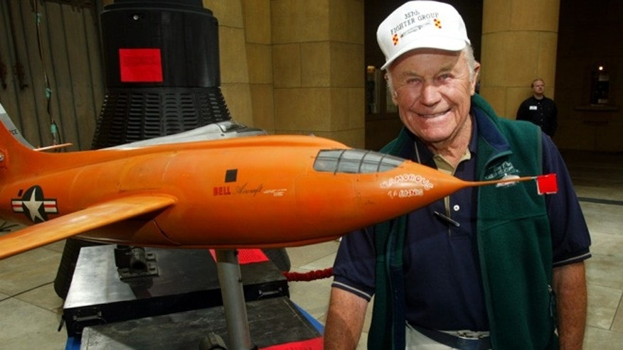 "June 9, 2003: Gen. Chuck Yeager, the first pilot to break the sound barrier in the Bell X-1 ""Glamorous Glinnis"" in October 1947, poses next to a minature of the plane used in the film ""The Right Stuff,"" at a screening in Hollywood."