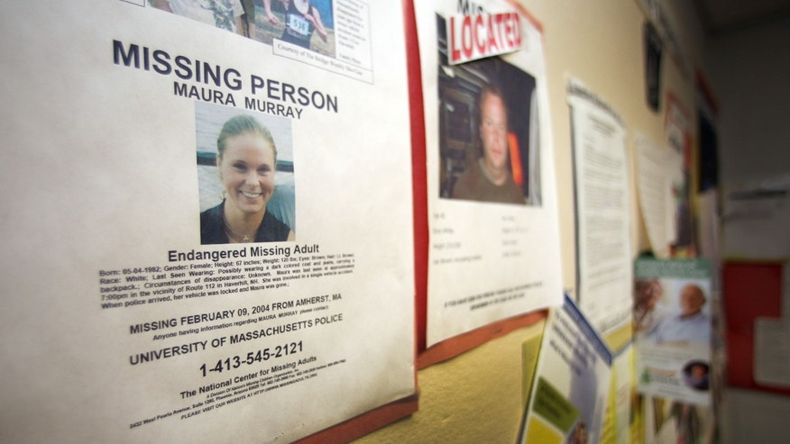 In this Tuesday Feb. 4, 2014 photo, a missing person poster of Maura Murray hangs in the lobby of the police station in Haverhill, N.H. Ten years ago, the Massachusetts college student drove off a road in a rural section of Haverhill in northern New Hampshire and hasn't been seen since. She left a tormented family, vexed investigators and a case rife with rumor and innuendo.  (AP Photo/Jim Cole)