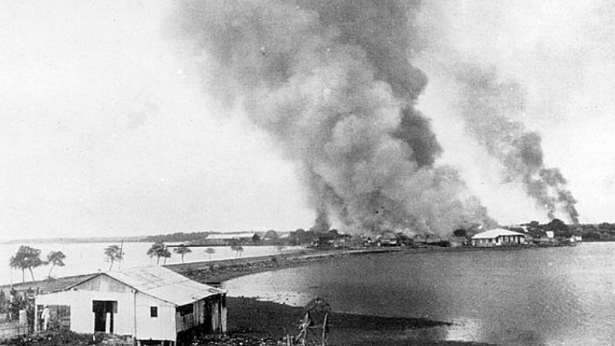 An undated photo shows the burning of San Roque, Philippines, during the Spanish-American War.