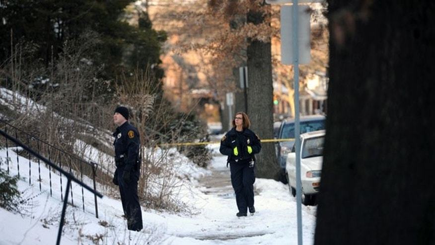 Feb. 7, 2014: Police investigate the scene were the bodies of sisters Susan Wolfe and Sarah Wolfe were found in the basement of their home in Pittsburgh. The two were sisters of an Iowa state representative, Mary Wolfe. Police said that they are investigating the case as a double homicide.