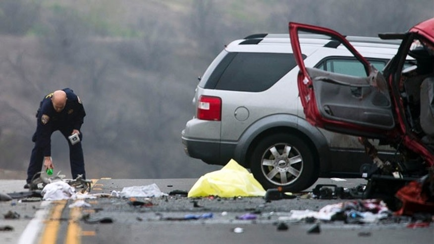 Feb. 9, 2013: Officials investigate the scene of a multiple vehicle accident where six people were killed on the westbound Pomona Freeway in Diamond Bar, Calif.