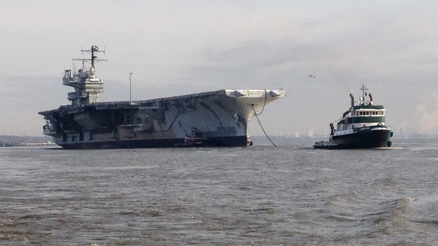 Feb. 4, 2014: The 1,067-foot ship, which was shut down in 1993, is seen being towed from Philadelphia on Tuesday. The trip is expected to last 17 days, weather permitting, company officials told FoxNews.com (Courtesy: All Star Metals)