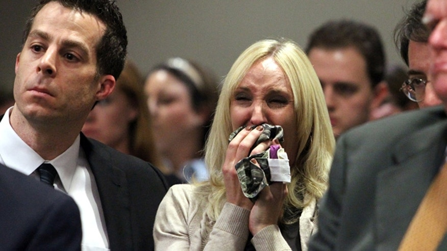 Feb. 5: Nicole Oulson, whose husband was shot inside a movie theater, reacts at the alleged shooter's bond hearing.