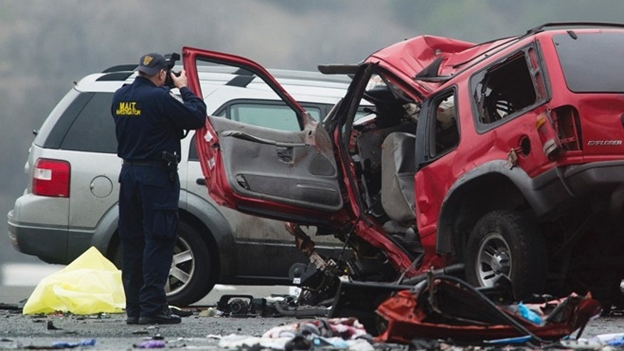 Feb. 9, 2014: Officials investigate the scene of a multiple vehicle accident where 6 people were killed on the westbound Pomona Freeway in Diamond Bar, Calif., on Sunday. Authorities say a wrong-way driver caused the pre-dawn crash that left six people dead.  (AP/San Gabriel Valley Tribune,Watchara Phomicinda)