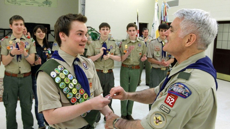 Feb. 10, 2014: Pascal Tessier, left,  a gay Boy Scout, receives his Eagle Scout badge from Troop 52 Scoutmaster Don Beckham in Chevy Chase, Md.