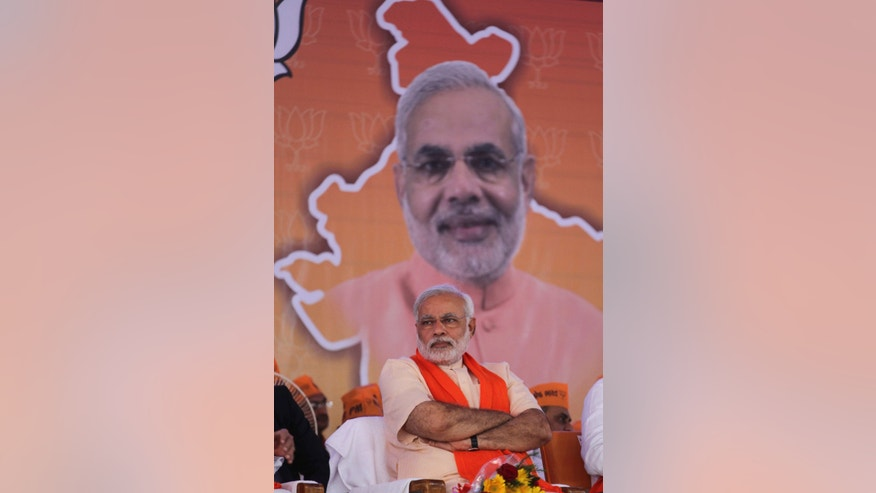 Gujarat state chief minister and Bharatiya Janata Party's prime ministerial candidate Narendra Modi sits during party workers' convention after inaugurating the party's new state headquarters building in Gandhinagar, India, Monday, Feb. 10, 2014. (AP Photo/Ajit Solanki)
