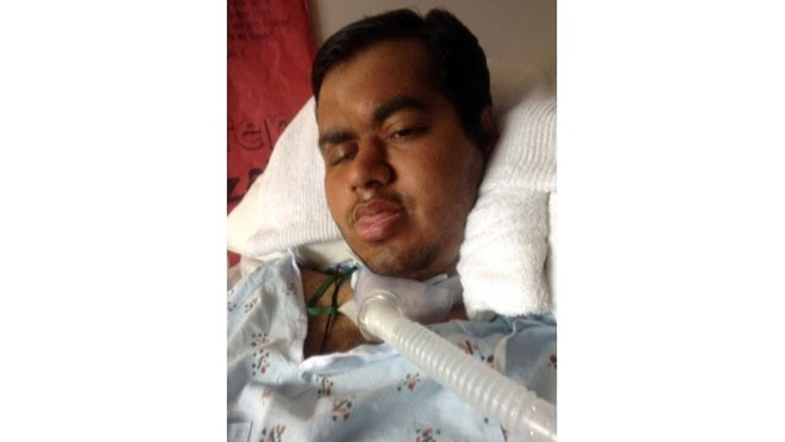 This 2014 photo provided by Shahraiz Bajwa taken at Essentia Health-St. Mary's Medical Center in Duluth, Minn. shows Muhammad Shahzaib Bajwa, of Pakistan, who has been comatose since being injured in a November crash while spending a semester in an exchange program at the University of Wisconsin-Superior. His family is trying to prevent the hospital from sending him back to his home country. A hospital spokeswoman said Bajwa won't be able to stay in the country legally after his student visa expires Feb. 28. (AP Photo/Courtesy Shahraiz Bajwa)