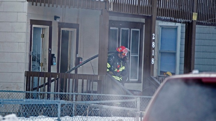 Feb. 14, 2014: Minneapolis firefighters respond to a fire at a duplex in Minneapolis.  Fire officials say three children have died and five other people have been injured in the fire.   More than 40 firefighters responded to the fire about 5 a.m. Minneapolis Fire Chief John Fruetel says firefighters encountered heavy smoke and fire on the second and third floor of the duplex as they searched the building for victims. (AP/The Star Tribune, Elizabeth Flores)