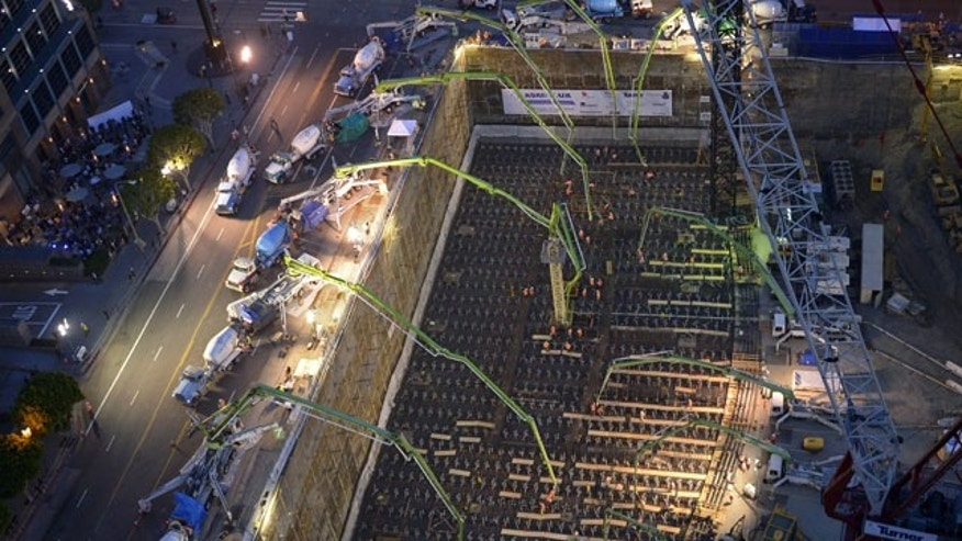 February 15, 2014: Crews pour concrete to lay the foundation for the New Wilshire Grand building in a record attempt for the largest continuous concrete pour in history in downtown Los Angeles. The marathon pour is expected to last 20 hours without interruption. (AP Photo/Mark J. Terrill)