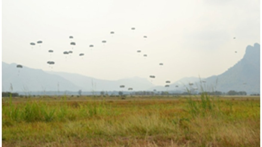 Approximately 400 U.S. and Royal Thai armed forces service members parachuted into Lop Buri, Thailand, Saturday as part of Exercise Cobra Gold 14. This training opportunity demonstrated the ability to rapidly deploy combat ready forces in the Asia-Pacific Region. (Courtesy: U.S. military)