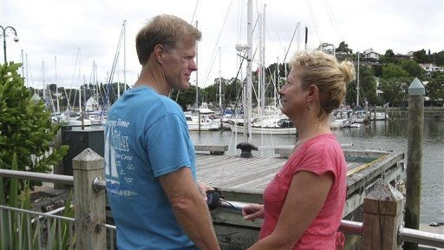 Ricky and Robin Wright, from Lafayette, Louisiana, stand at a dock in the New Zealand port of Whangarei, where the wooden sailboat Nina was moored in 2013.