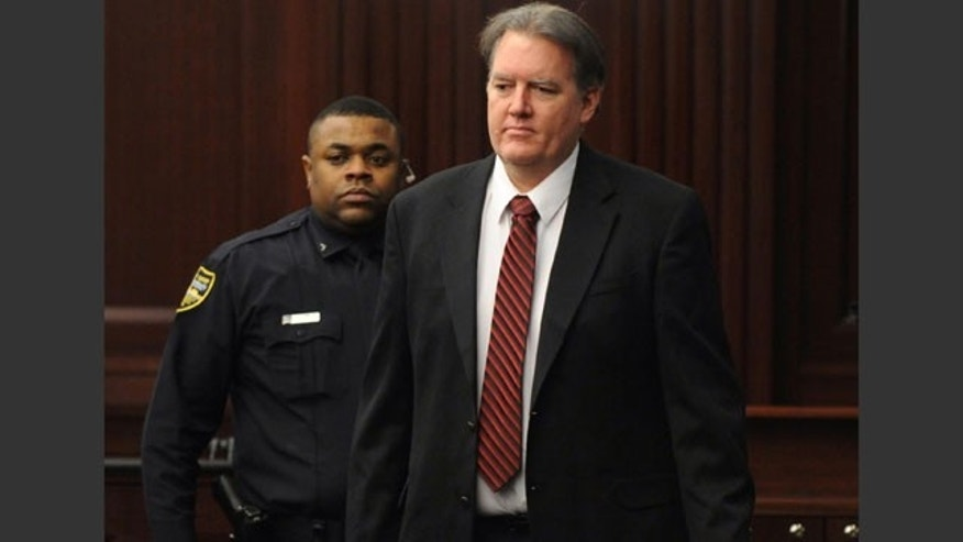 February 15, 2014: Defendant Michael Dunn is brought into the courtroom, where Judge Russell Healey announced that the jury was deadlocked on charge one and have verdicts on the other four charges as they deliberate in the trial of Dunn for the shooting death of Jordan Davis in November 2012. (AP Photo/The Florida Times-Union, Bob Mack, Pool)
