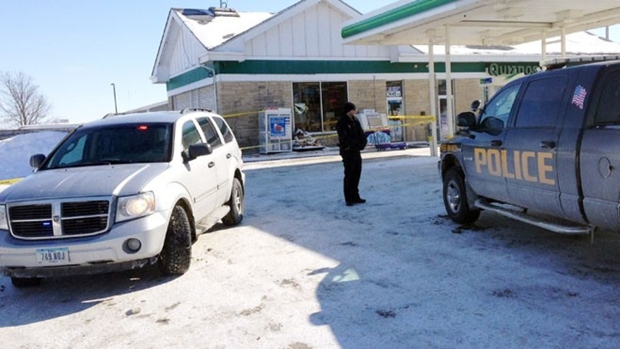 Feb. 7, 2014: Authorities gather at a gas station in West Branch, Iowa, where a missing newborn was found alive.