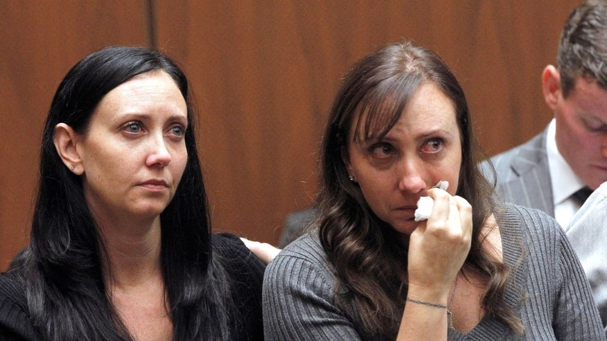 Evin Collins, and Bonnie Stow, sisters of beating victim Bryan Stow are shown during a hearing Thursday Feb. 20, 2014 in Los Angeles. Two men, Marvin Norwood, and Louie Sanchez  pleaded guilty Thursday to a 2011 beating at Dodger Stadium that left San Francisco Giants fan Stow brain damaged and disabled. The pair were  immediately sentenced by an angry judge who called them cowards and the sort of people that sports fans fear when they go to games.(AP Photo/Nick Ut )