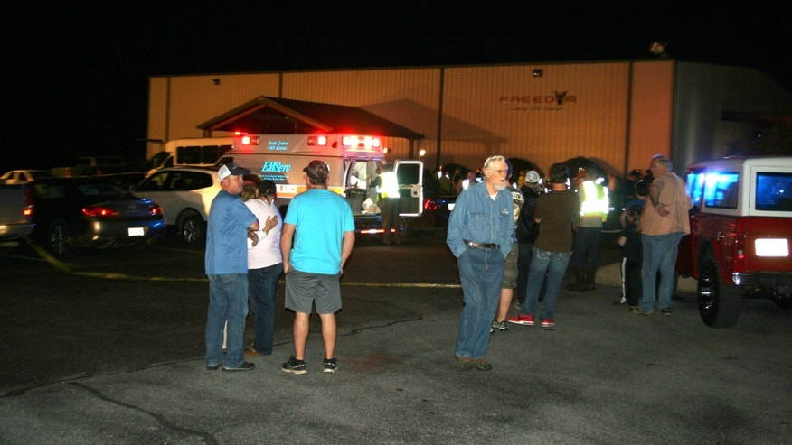 Emergency responders, members of Freedom Baptist Church, and Myrick community members in rural Jones County, Miss. gather outside Freedom Baptist Church Wednesday night after a second floor youth room collapsed onto a first floor kitchen. Up to 35 youth ages from seventh grade to 12th grade were injured. A 16-year-old girl who suffered a head injury was airlifted to Forrest General Hospital in Hattiesburg.  (AP Photo/The Chronicle, Jason Niblett)