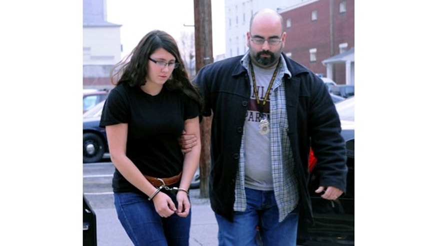 FILE - In this Tuesday, Dec. 3, 2013 file photo, Miranda K. Barbour is led into District Judge Ben Apfelbaum's office in Sunbury, Pa., by Sunbury policeman Travis Bremigen. Authorities say police have yet to substantiate Bremigen's claim that she killed more than 20 people in four states before the murder she is now charged with committing. (AP)