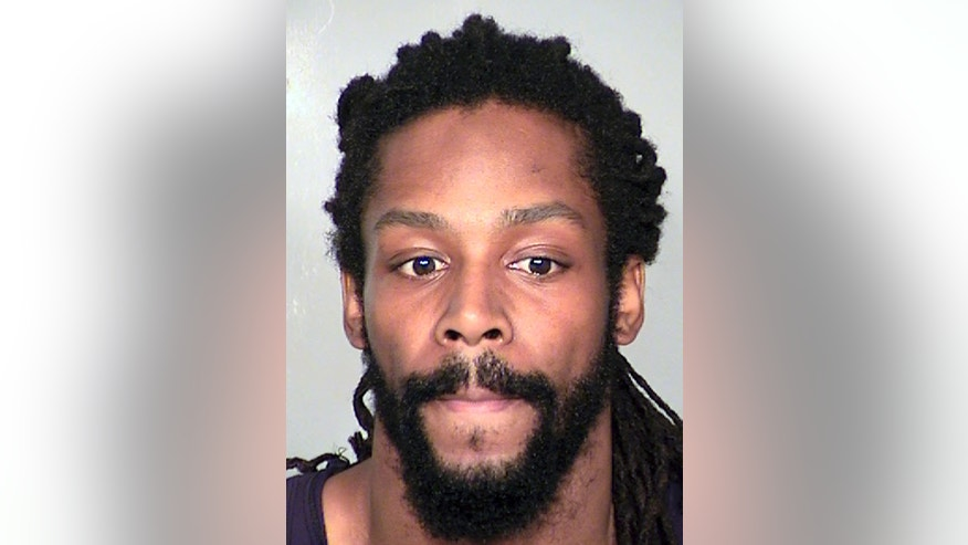 This image provided by the Clark County Detention Center shows Kirk Bills, who has been accused of trying to burn a pet shop where 27 puppies were rescued last month.  Bills has been returned in custody to Las Vegas to face arson and other charges, authorities said Thursday, Feb. 20, 2014. (AP Photo/Clark County Detention Center)