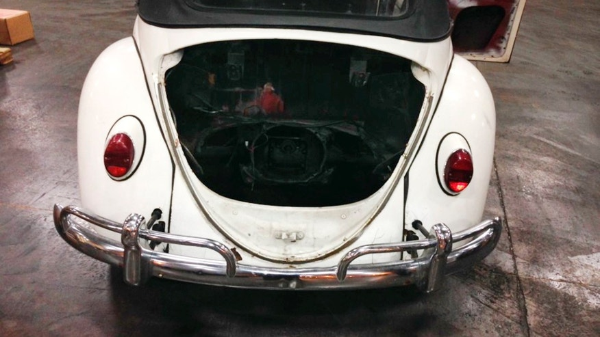 UNDATED: In a handout photo provided by the Customs and Border Protection, a 1965 Volkswagen Beetle stolen 40 years ago in Tennessee is seen in Detroit.