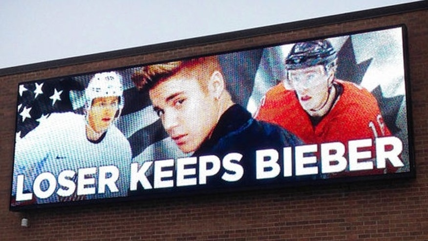 UNDATED: An electronic billboard displays pop star Justin Bieber, center, sandwiched by Chicago Blackhawks stars Patrick Kane, left, and Jonathan Toews outside the Skokie, Ill., based freight company.