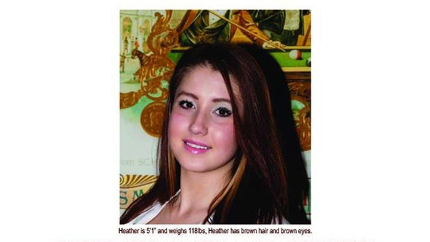 Heather Elvis, 20, is pictured in a missing person flyer.