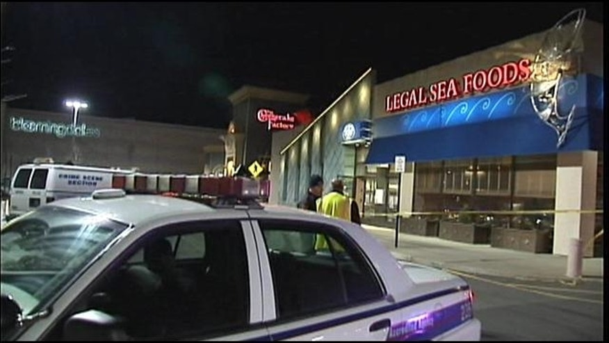 February 22, 2014: Authorities gather outside the Walt Whitman Shops in Huntington Station, N.Y. following a gas leak (MyFoxNY.com)