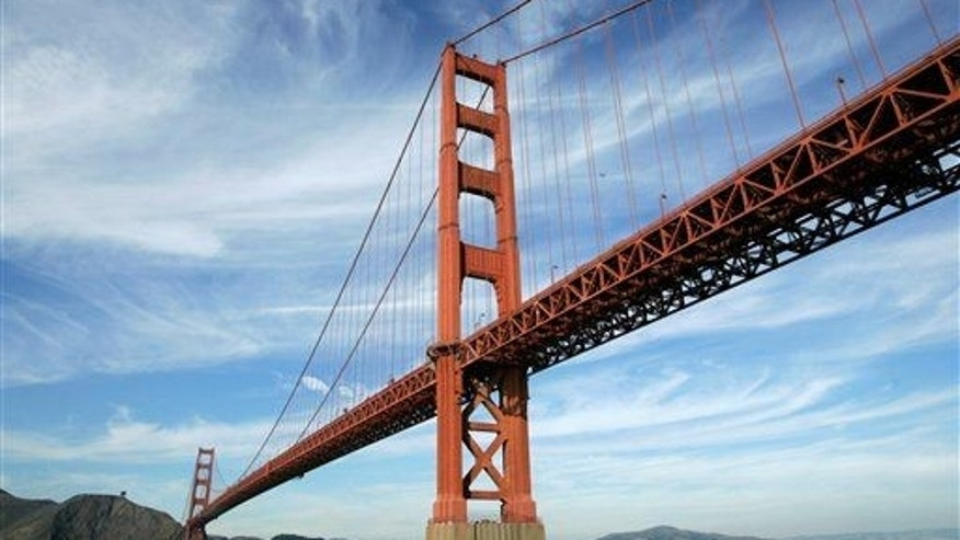 Golden Gate Bridge officials have voted to hang a stainless steel net below the iconic span to stop suicides, but it has yet to be built.