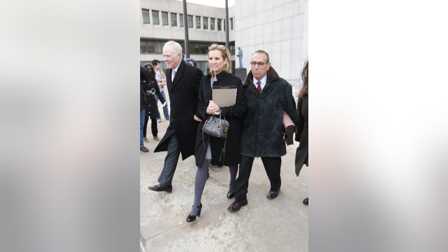 Kerry Kennedy, center, leaves the Westchester County Courthouse in White Plains, N.Y. with her attorneys on Monday, Feb. 24, 2014 following the first day her trial. Kennedy, the ex-wife of New York Gov. Andrew Cuomo and the niece of the late President John F. Kennedy, was arrested in 2012 after her car hit a tractor-trailer on an interstate highway near her home outside New York City. She drove to the next exit, where she failed a sobriety test, police said. (AP Photo/The Journal News, Ricky Flores) NYC OUT, NO SALES, ONLINE OUT, TV OUT, NEWSDAY INTERNET OUT; MAGS OUT