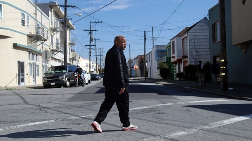 Feb. 13, 2014: Ernest Morgan walks around his neighborhood in San Francisco.