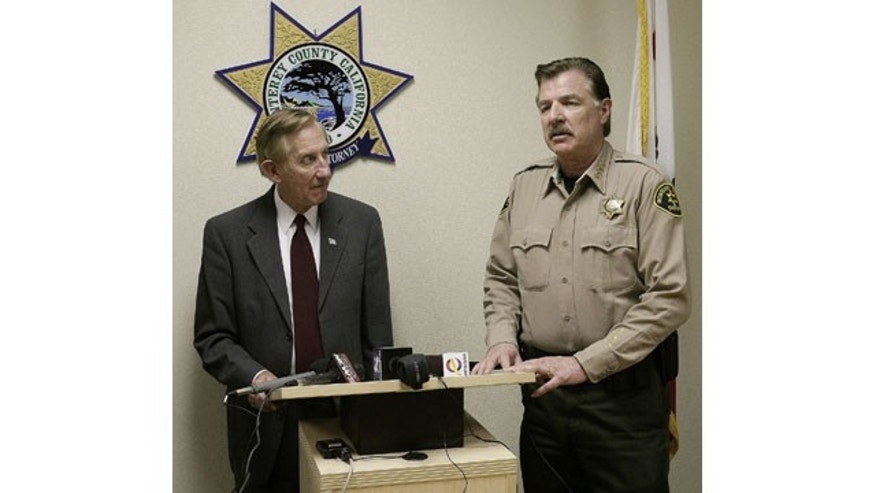 February 25, 2014: Monterey County District attorney Dean Flippo, left, and Monterey County Sheriff Scott Miller answer questions during a news conference in Salinas, Calif. Flippo said that six King City, Calif. officers, including the recently retired police chief and the acting chief, have been arrested, in connection to a scheme to steal more than 200 cars from poor Hispanic people. (AP Photo/The Monterey County Herald, Vern Fisher)