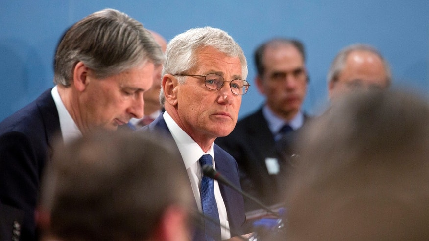 U.S. Secretary of Defense Chuck Hagel, center, attends a meeting of defense ministers of the North Atlantic Council at NATO headquarters in Brussels on Wednesday, Feb. 26, 2014. Frustrated with his Afghan counterpart, U.S. President Barack Obama is ordering the Pentagon to accelerate planning for a full U.S. troop withdrawal from Afghanistan by the end of this year. But Obama is also holding out hope that Afghanistan's next president may eventually sign a stalled security agreement that could prevent the U.S. from having to take that step. (AP Photo/Virginia Mayo)