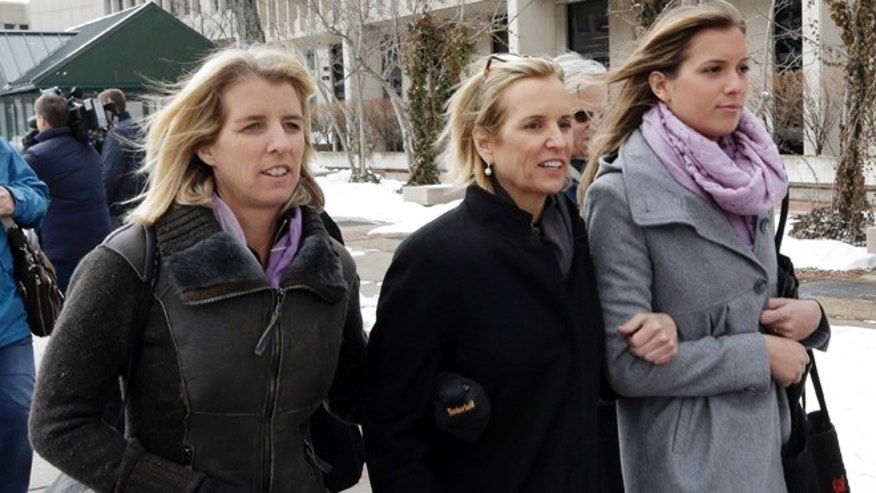Feb. 26, 2014: Kerry Kennedy, center, leaves Westchester County courthouse with family in White Plains, N.Y. Kennedy testified Wednesday that she did not knowingly take a sleeping pill on the day her Lexus swerved into a tractor-trailer on a suburban New York highway.