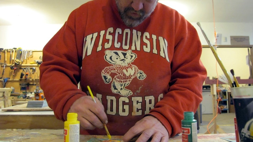 "In this Jan. 16, 2014 photo, Harold ""Hap"" Morgan works in the OM Build workshop in Madison, Wis. He is in line to get one of the nine houses planned to be built by the group to help those without permanent homes. (AP Photo/Carrie Antlfinger)"