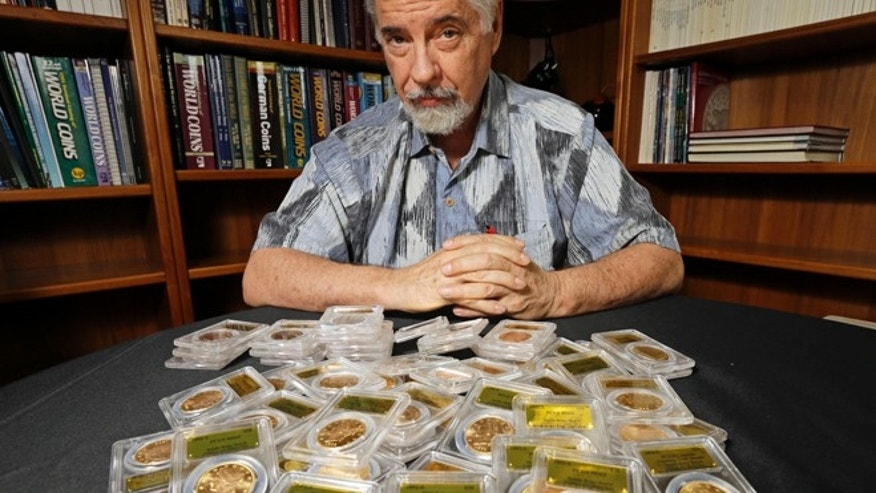 Feb. 25: David Hall, co-founder of Professional Coin Grading Service, poses with some of 1,427 Gold-Rush era U.S. gold coins, at his office in Santa Ana, Calif.