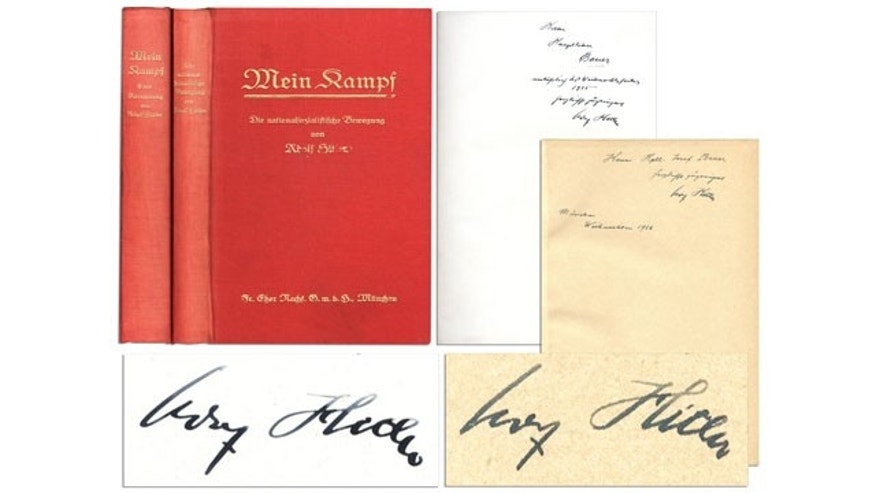 "This undated image provided by Nate D. Sanders Auction shows the Adolph Hitler inscribed ""Mein Kampf"" volume to future SS leader Joseph Bauer. The signed two-volume set of ""Mein Kampf"", the manifesto of the future Fuhrer will be auctioned by Nate D. Sanders on Thursday, Feb. 27, 2014. Interested bidders may participate in the auction online.  (AP)"