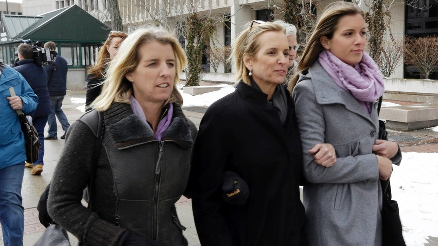 Kerry Kennedy, center, leaves Westchester County courthouse accompanied by family members Wednesday, Feb. 26, 2014, in White Plains, N.Y. Kennedy testified Wednesday that she did not knowingly take a sleeping pill on the day her Lexus swerved into a tractor-trailer on a suburban New York highway. (AP Photo/Frank Franklin II)
