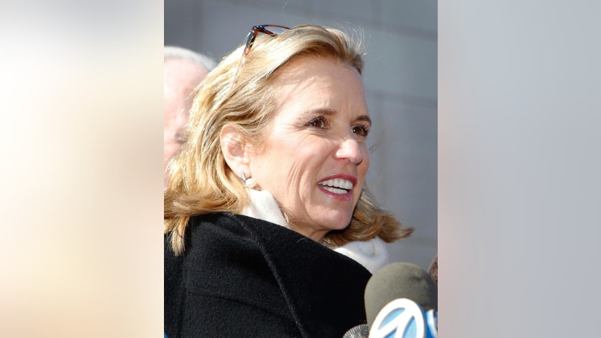Kerry Kennedy talks to reporters after leaving the Westchester County Courthouse, Friday, Feb. 28, 2014 in White Plains, N.Y. Kennedy was acquitted Friday of drugged driving after she accidentally took a sleeping pill and then sideswiped a truck in a wild highway drive in July, 2012, she said she didn't remember. (AP Photo/The Journal News, Tania Savayan)