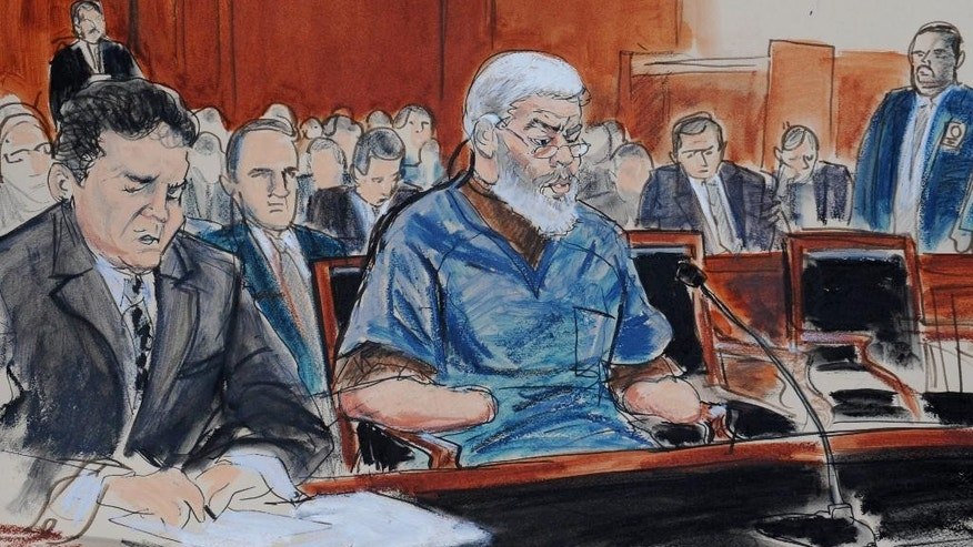 FILE- In this Oct. 9, 2013 file courtroom drawing, defense attorney, Jeremy Schneider, left, represents accused terrorist Mustafa Kamel Mustafa, center, in Manhattan federal court, in New York. In a document filed with the court dated Feb. 21, 2014, on Thursday, Feb. 27, Mustafa informed judge Katherine Forrest that he plans to testify at his terrorism trial in April 2014. (AP Photo/ Elizabeth Williams, File)