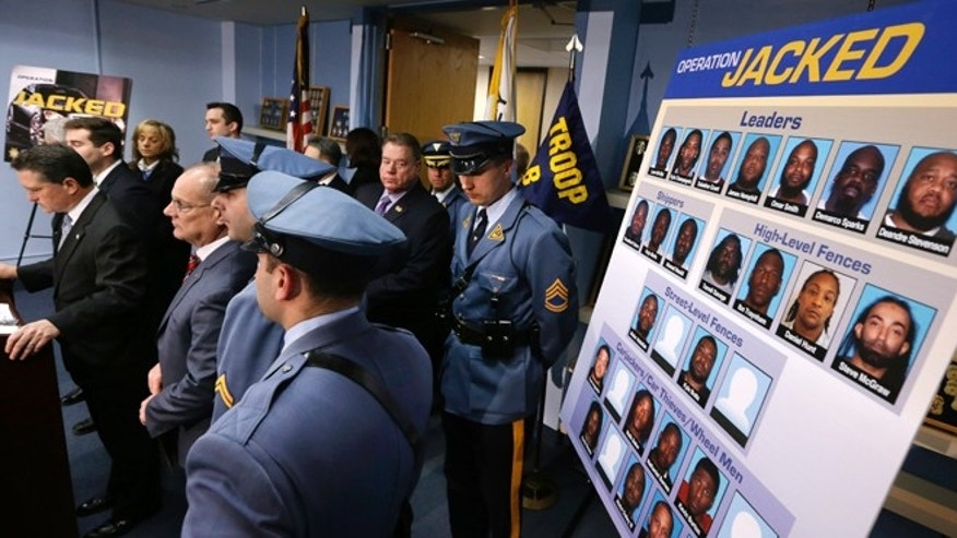 Feb. 27, 2014: Acting New Jersey Attorney General, John Jay Hoffman, left, stands with police officials during a news conference in Totowa, N.J., as he announces that nearly three dozen people were arrested or charged in what authorities said was a takedown of an auto theft ring that used tactics including carjackings in New York and New Jersey to help feed a demand for luxury sport utility vehicles in West Africa. Hoffman says more than 160 vehicles were recovered in the 10-month investigation. (AP/Mel Evans)